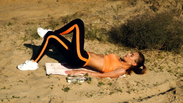 sports girl doing exercises for ABS video