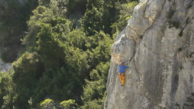 Sports, male athlete training and climbing on rocks video