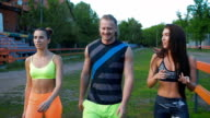 Sports people. The boy and two girls are after your workout fun and something to discuss video