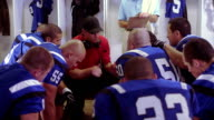 Sports team huddles in locker room video