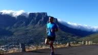 Sportsman enjoying her run above the city video