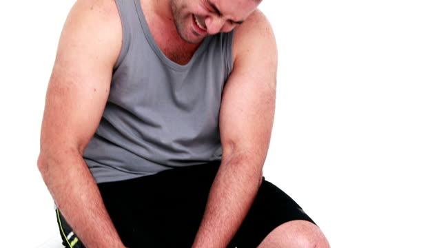 Sportsman with cramp video