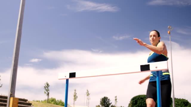 Sportswoman doing hurdle race video