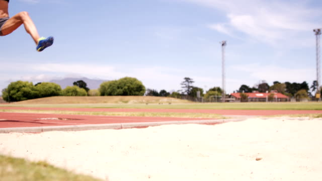 Sportswoman doing long jump video
