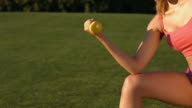 Sportswoman exercising with dumbbells. video