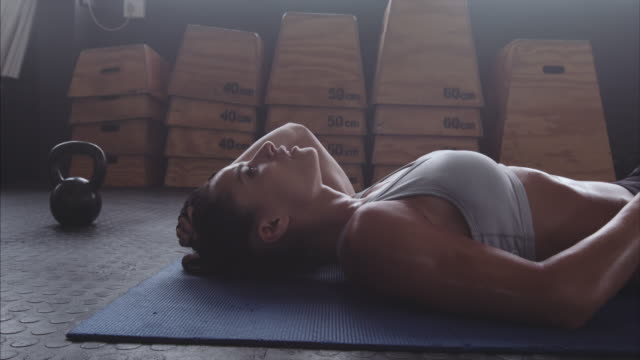 Sportswoman resting after intense fitness training video