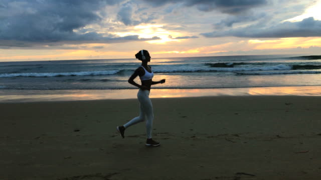 Sporty Female Running On The Beach video