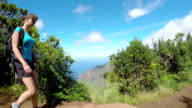 CLOSE UP: Sporty female walking down the mountain path in lush Hawaii mountains video