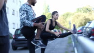 Sporty friends talking while exercising in city video