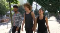 Sporty friends walking under bridge video