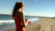 Sporty girl using smart watch video