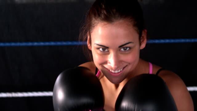 Sporty happy brunette boxing video