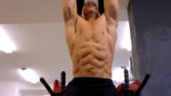 sporty man does exercises in the gym video