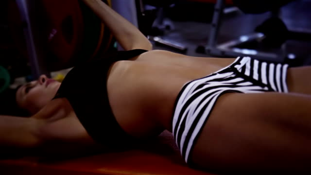 Sporty woman doing bench press video