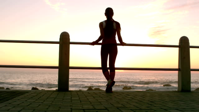 Sporty woman make a break during her jogging video