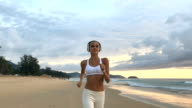 Sporty Woman Running At Beach video