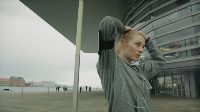 Sporty woman running in the city video
