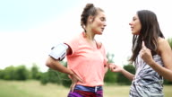 Sporty women chat in the park video