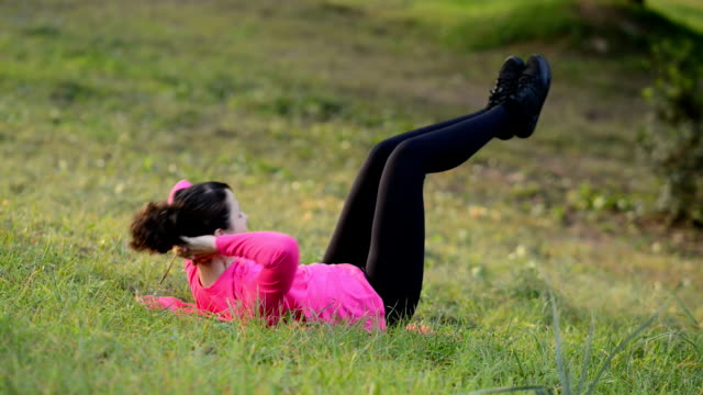 sporty women doing sport exercise in the park video