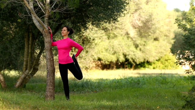 sporty women doing streching exercising in the park video