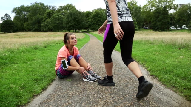 Sporty women motivate her friend and go video