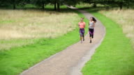 Sporty women running together video