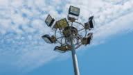 Spotlight, Stadium lights, with blue sky timelapse video