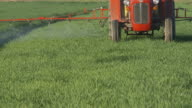 HD DOLLY: Spraying Crop With A Tractor video