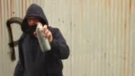 Spraying 'Peace' in Graffiti on glass video