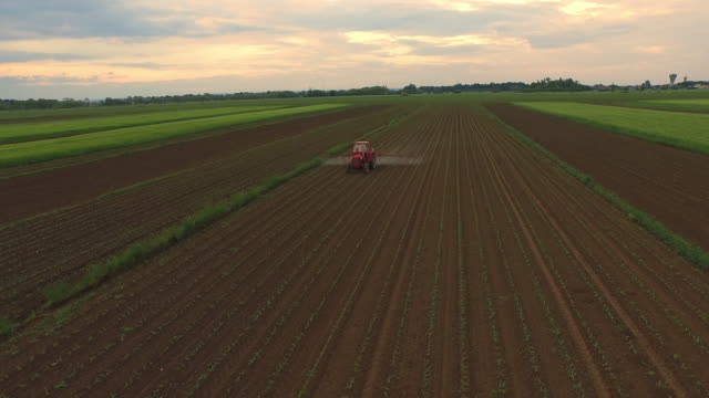 AERIAL Spraying pesticides on a field video