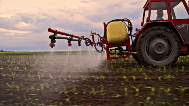Spraying pesticides on a field video