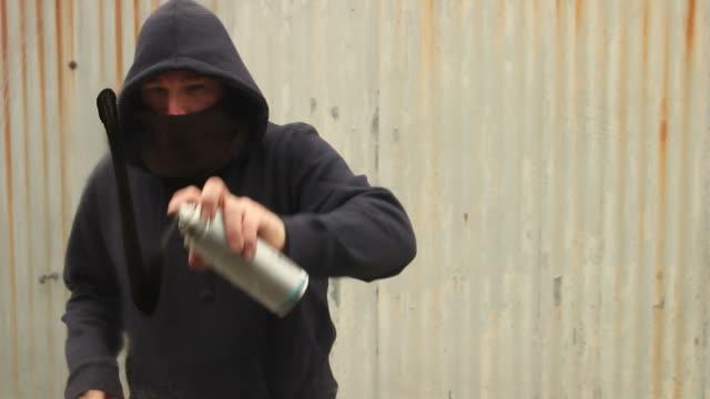 Spraying 'War' in Graffiti on glass video
