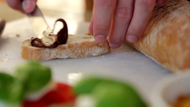 Spreading nougat creme on a slice of bread video