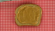 Spreading peanut butter and jelly on bread, Slow Motion video
