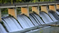 Spring flood water flowing on hydroelectric power station dam video