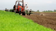 Spring planting corn in a field video