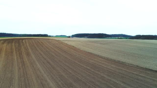 Spring tillage - aerial view 4K. video