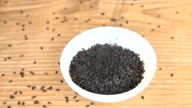Sprinkle black sesame seeds into a cup video