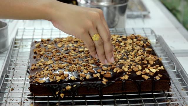 Sprinkle cashew on brownies video