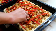 Sprinkle homemade pizza blank red bell peppers and tomatoes video
