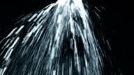 Sprinkler sprinkling water, black background video