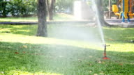 Sprinklers water the grass video