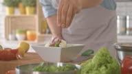 Sprinkling chopped nuts onto salad video