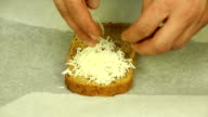 Sprinkling grated cheese bread video