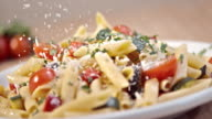 SLO MO Sprinkling parmesan over pasta with fresh vegetables video