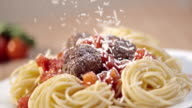 SLO MO Sprinkling parmesan over spaghetti and meatballs video