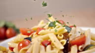 SLO MO sprinkling parsley over fresh vegetable pasta video