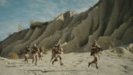 Squad of Fully Equipped, Armed Soldiers Running and Attacking During Battle in the Desert. video