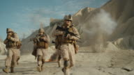 Squad of Fully Equipped, Armed Soldiers Running and Attacking During Military Operation in the Desert. Slow Motion. video