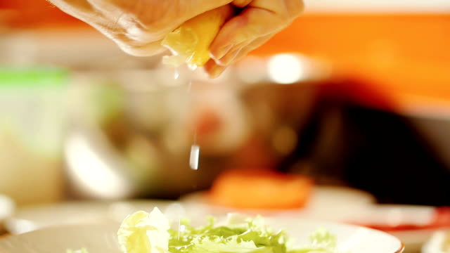 Squeezing lemon juice on the salad greens video
